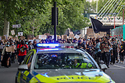 British mounted police officers secure the area as people, most wearing protective masks against the spread of coronavirus, march towards Parliament Square in a demonstration organised by the Black Lives Matter movement, who held the fourth weekend of protests in Central London, on Sunday, June 21, 2020. Anger against systemic levels of institutional racism have raged through the city, and worldwide; sparked by the death of George Floyd in the United States last month. (Photo/ Vudi Xhymshiti)