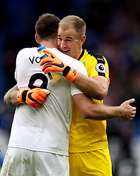 Burnley's Sam Vokes (left) and Burnley goalkeeper Joe Hart (right) celebrate after the final whistle during the Premier League match at the Cardiff City Stadium.