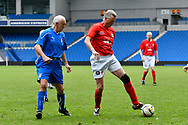 Alan Davies of England over 60's with Aldo Dondi of Italy close by during the world's first Walking Football International match between England and Italy at the American Express Community Stadium, Brighton and Hove, England on 13 May 2018. Picture by Graham Hunt.