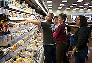 Cody Jordan, left, points out a particular cheese at the Trader Joe's location on 400 South and 600 East, opening this Friday at 8:00am , Tuesday, Nov. 27, 2012.