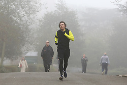 © Licensed to London News Pictures. 03/03/2021. London, UK. Runners in Finsbury Park, north London on a foggy morning. The Met Office has issued a yellow weather warning for fog in some parts of south east England with low visibility. Photo credit: Dinendra Haria/LNP