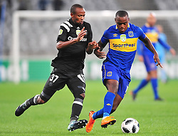 Cape Town 180314.Cape Town City midfielder Ayanda Patosi challenged  by Xola Mlabo  of Orland Pirates in  aNedbank  geme taking place at the Cape Town Stadium. Photograph:Phando Jikelo/AFRICAN NEWS AGENCY/ANA