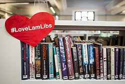© Licensed to London News Pictures. 01/04/2016. London, UK. A placard attached to a bookshelf in Herne Hill's Carnegie Library, which is currently occupied by local residents in an effort to prevent its closure. Lambeth Council had planned to close the library last night (31st March) in order to turn it into a 'healthy living centre'. Photo credit : Rob Pinney/LNP