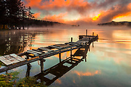 Wooden quay in a mountain lake at sunrise