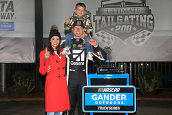 February 23, 2019 - Hampton, GA, U.S. - HAMPTON, GA - FEBRUARY 23:  Kyle Busch, KBM Toyota Tundra celebrates with his family after winning the 11th running of the Ultimate Tailgating 200 NASCAR Gander Outdoors Truck Series race on February 23, 2019 at the Atlanta Motor Speedway in Hampton, GA.  (Photo by David J. Griffin/Icon Sportswire) (Credit Image: © David J. Griffin/Icon SMI via ZUMA Press)