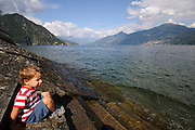Italy, Lombardy, child relaxing at Lake Como. Model released