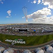 The United States Air Force Thunderbirds fly over the track prior to the start of the 57th Annual NASCAR Daytona 500 race at Daytona International Speedway on Sunday, February 22, 2015 in Daytona Beach, Florida.  (AP Photo/Alex Menendez)