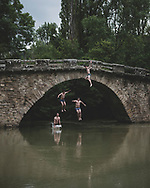 Alex, Pablo, Javier, and Guido, local 18-year-olds, jump from the Puente de Iturgaiz into the Arga River in Irotz, Spain. The Camino de Santiago crosses the bridge. (May 30, 2018)<br />