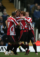 Photo: Lee Earle.<br /> Portsmouth v Sheffield United. The Barclays Premiership. 23/12/2006. United's Rob Hulse (2ndL) is congratulated after scoring their opening goal.