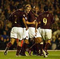 Photo: Chris Ratcliffe.<br />Arsenal v Sparta Prague. UEFA Champions League.<br />02/11/2005.<br />Thierry Henry (2nd, R) celebrates with his fellow Arsenal players