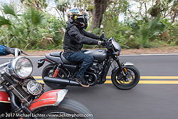 Custom bike builder Jesse Rooke on a new 2017 Harley-Davidson 750 Street Rod riding through Tomoka State Park during Daytona Beach Bike Week. FL. USA. Tuesday, March 14, 2017. Photography ©2017 Michael Lichter.