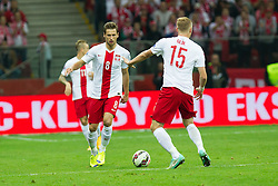 14.10.2014, Nationalstadium, Warsaw, POL, UEFA Euro Qualifikation, Polen vs Schottland, Gruppe D, im Bild GRZEGORZ KRYCHOWIAK ( L) // during the UEFA EURO 2016 Qualifier group D match between Poland and Scotland at the Nationalstadium in Warsaw, Poland on 2014/10/14. EXPA Pictures © 2014, PhotoCredit: EXPA/ Newspix/ Katarzyna Plewczynska<br /> <br /> *****ATTENTION - for AUT, SLO, CRO, SRB, BIH, MAZ, TUR, SUI, SWE only*****