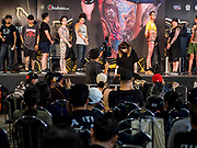 28 OCTOBER 2018 - BANGKOK, THAILAND: People on stage during the judging of the Realistic division at the 2018 MBK Center Tattoo Fest. Tatoo artists from around the world came to participate in the festival, which featured both modern (using tattoo machines) and traditional methods (done by hand with long needles) of tattooing.    PHOTO BY JACK KURTZ