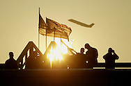 A 8.3  MG FIMAGE OF:.Arlington, VA 9/11/02 The sun rises over the Pentagon while a Secret Service ERT team prepares for a Presidential visit. A plane that has just taken off from Reagan National Airport is in background.  Photo by Dennis Brack