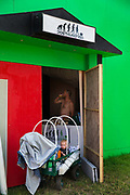 Glastonbury Festival, 2015. Shangri La is a festival of contemporary performing arts held each year within Glastonbury Festival. The theme for the 2015 Shangri La was Protest.  Baby in a sleep cart in front of Shangri La night club with the theme Posthumanism.