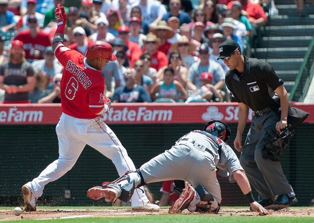 Home plate umpire Gabe Morales has a pretty good view as the Angels' Yunel Escobar fails to step on home plate as the ball gets away from Red Sox catcher Ryan Hanigan in the first inning at Angel Stadium on Sunday.<br /> <br /> ///ADDITIONAL INFO:   <br /> <br /> angels.0730.kjs  ---  Photo by KEVIN SULLIVAN / Orange County Register  -- 7/31/16<br /> <br /> The Los Angeles Angels take on the Boston Red Sox at Angel Stadium.
