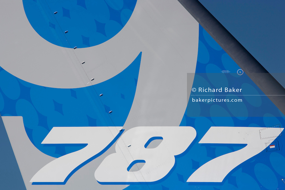Detail of a Boeing 787-9 Dreamliner jet airliner tailplane at the Farnborough Air Show, England. The Boeing 787-9 Dreamliner is the second member of the super-efficient 787 family. Both the 787-8 and 787-9 bring the economics of large jets to the middle of the market, with 20 percent less fuel use and 20 percent fewer emissions.