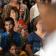 A woman with a baby listens as President Barack Obama speaks during his Grassroots event at the Kissimmee Civic Center in Kissimmee, Florida on Saturday, September 8, 2012. (AP Photo/Alex Menendez)