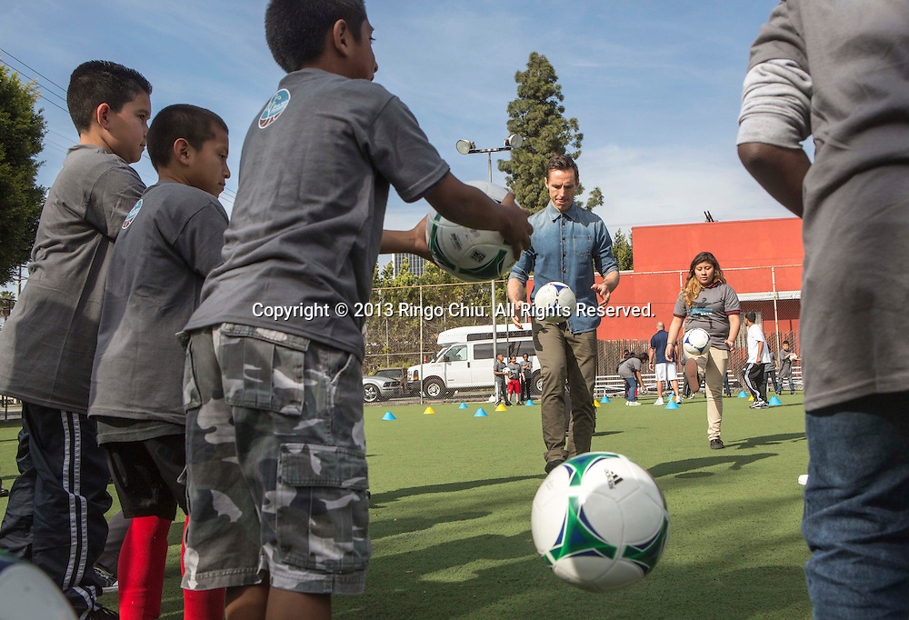 NBA Los Angeles Lakers point guard Steve Nash plays soccer ball with the youth soccer players during a news conference on Wednesday  March 20, 2013 in Los Angeles California, to announces his foundation's charity soccer events that will take place in New York and Los Angeles this summer.  (Photo by Ringo Chiu/PHOTOFORMULA.com).
