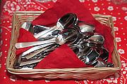 Basket of spoons. Annual Swedish Julbord at the American Swedish Institute Minneapolis Minnesota USA