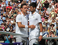Tennis - 2019 Wimbledon Championships - Week Two, Friday (Day Eleven)<br /> <br /> Men's Singles, Semi-Final: Novak Djokovic (SRB) vs. Roberto Bautista Agut (ESP)<br /> <br /> Novak Djokovic consoles Bautista Agut at the net after the match, on Centre Court.<br /> <br /> COLORSPORT/ANDREW COWIE