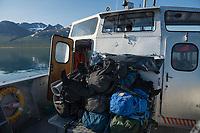 Hiker backpacks on MS Storlule ferry boat over lake Akkajaure between Ritsem - Änonjalmme, Padjelantaleden Trail, Lapland, Sweden