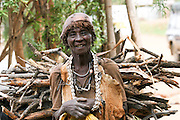Africa, northern Ethiopia, Lalibela, smiling woman carries sticks and twigs on her back for cooking