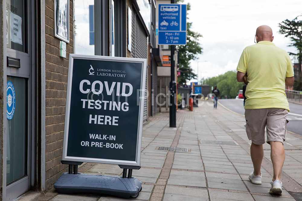 A Covid testing sign is pictured outside a private laboratory on 10th July 2021 in Slough, United Kingdom. Surge testing is also being carried out at targeted locations in Slough by Slough Borough Council with the purpose of preventing the spread of new forms of Covid at the very earliest stage.
