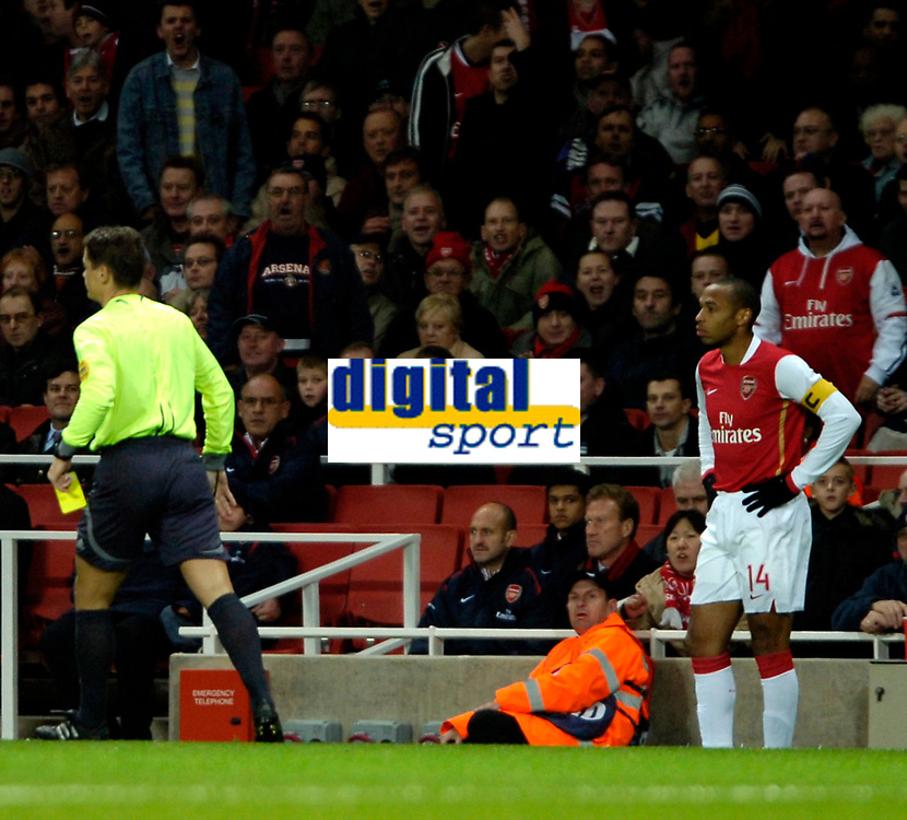 Photo: Ed Godden.<br /> Arsenal v CSKA Moscow. UEFA Champions League, Group G. 01/11/2006. Arsenal Captain Thierry Henry can't beleive he is given a yellow card within the first 5 minutes.