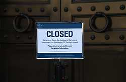 A sign announcing closure of the National Archives due to a partial government shutdown is displayed in Washington, D.C., U.S., on December 24, 2018. Parts of the U.S. government shut down on Saturday for the third time this year after a bipartisan spending deal collapsed over President Donald Trump's demands for more money to build a wall along the U.S.-Mexico border. Photo by Olivier Douliery/ABACAPRESS.COM