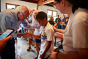 07212019 - Ft. Madison, Iowa, USA: Senator Bernie Sanders thanks Diallo Perkins, 9-years-old, for attending his campaign event after Sanders, who is running for the Democratic nomination for President of the United States, spoke at the Rodeo Park Enclosed Shelter, Sunday, July 21, 2019 in Ft. Madison, Iowa. Perkins was attending the event with his mother and grandparents.