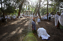 Elsa Haile, 20, prays at St. George Church while Senaiet, 5, looks on in Bahir Dar, Ethiopia on May 27, 2007.  At age 11, Elsa ran away from home the day she was supposed to get married to a neighboring villager. She was later offered a job in a restaurant, but it turned out to be a brothel. Elsa does not know who fathered her daughter and has yet decided to test herself or her child for HIV, but she hopes to someday escape from nightmare her life has become.