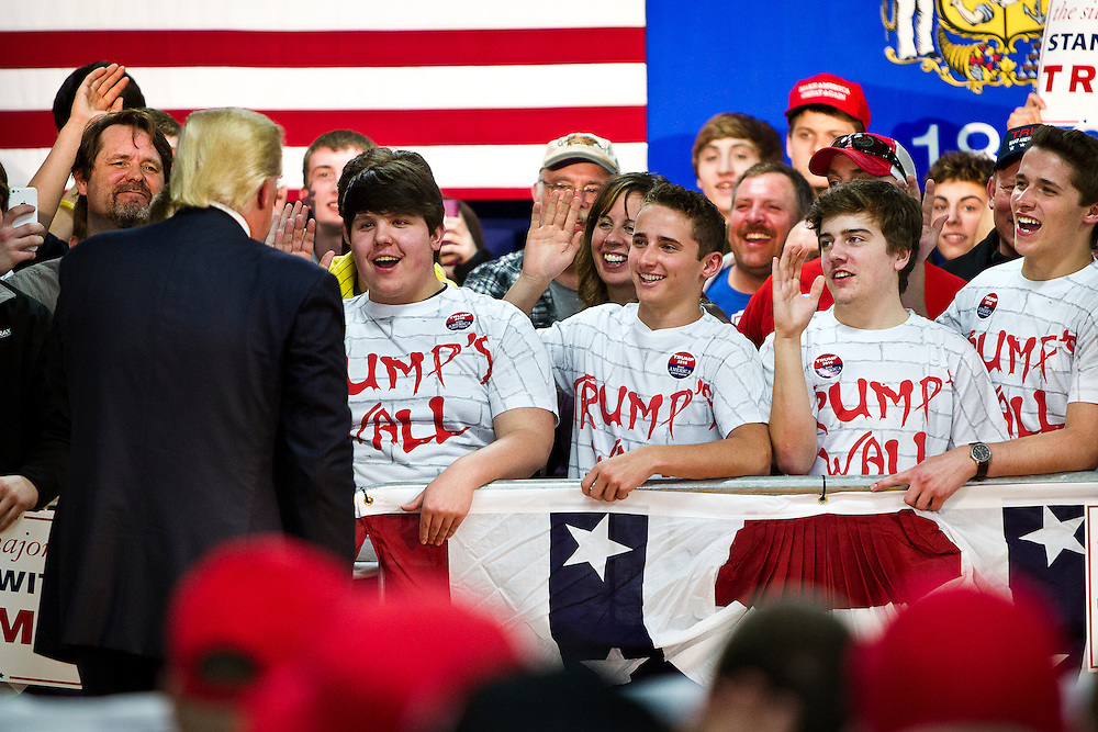 Young Donald Trump supporters raise their arms and pledge during Republican U.S. presidential candidate Donald Trump speech at a campaign town hall event in Wausau, Wisconsin April 2, 2016.   REUTERS/Ben Brewer