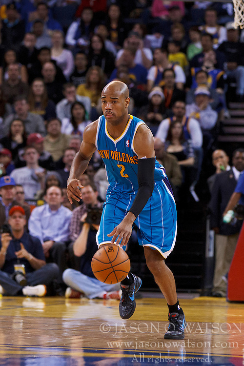 Mar 28, 2012; Oakland, CA, USA; New Orleans Hornets point guard Jarrett Jack (2) dribbles the ball against the Golden State Warriors during the second quarter at Oracle Arena. New Orleans defeated Golden State 102-87. Mandatory Credit: Jason O. Watson-US PRESSWIRE