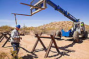 "03 MAY 2012 - VEKOL VALLEY, RURAL PINAL COUNTY, AZ:   James Peters (CQ), from the BLM office in Safford, works on the installation of vehicle barriers on Bureau of Land Management land south of Interstate 8 and west of Casa Grande in rural Pinal County. The area has been a hotbed of illegal immigrant and drug smuggling for years. The BLM has undertaken a series of ""surges"" in the area, increasing their law enforcement patrols and partnering with Border Patrol and Pinal County Sheriff's Department officers to reduce criminal activity in the area.        PHOTO BY JACK KURTZ"