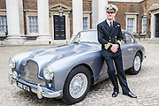 Commander Pat Douglas RN stands with the car before driving it to Dukes Hotel. An Aston Martin DB 2/4, which is understood to have been Ian Fleming's inspiration for James Bond's Aston Martin in the original novel Goldfinger. It was recently discovered and refurbished by owners  John and Daniel Walford.  It is to be auctioned on 12 July at Blenheim Palace  by international auctioneers Coys. The Old Admiralty Building, Whitehall London