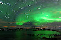 Star Trails and Northern Lights from Telegrafbukta Beach in Tromsø Norway. Image taken with a Nikon D800 and 24 mm f/1.4 lens (ISO 800, 24 mm, f/2, 8 sec). Composite of 68 images using Startrails.exe.