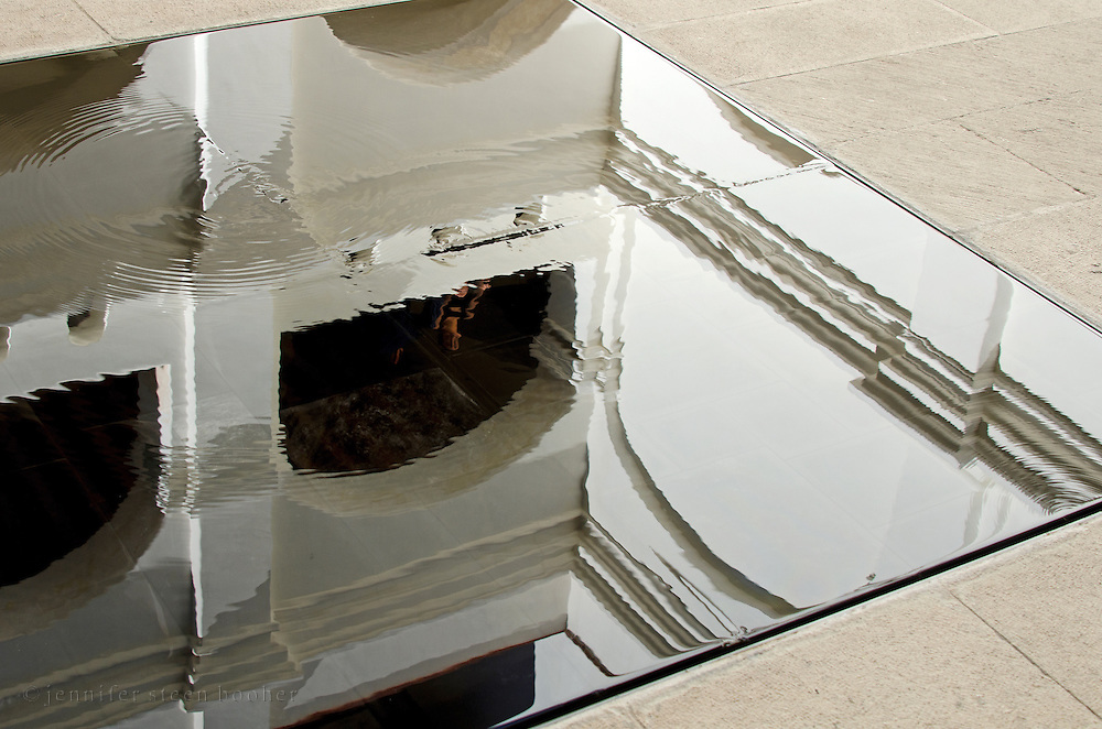 A shallow pool in the courtyard of the Centro Académico y Cultural San Pablo is as smooth as a mirror.