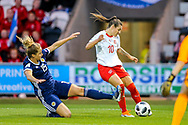 Ramona Bachmann (#10) of Switzerland crosses the ball beyond the challenge of Sophie Howard (#15) of Scotland during the 2019 FIFA Women's World Cup UEFA Qualifier match between Scotland Women and Switzerland at the Simple Digital Arena, St Mirren, Scotland on 30 August 2018.