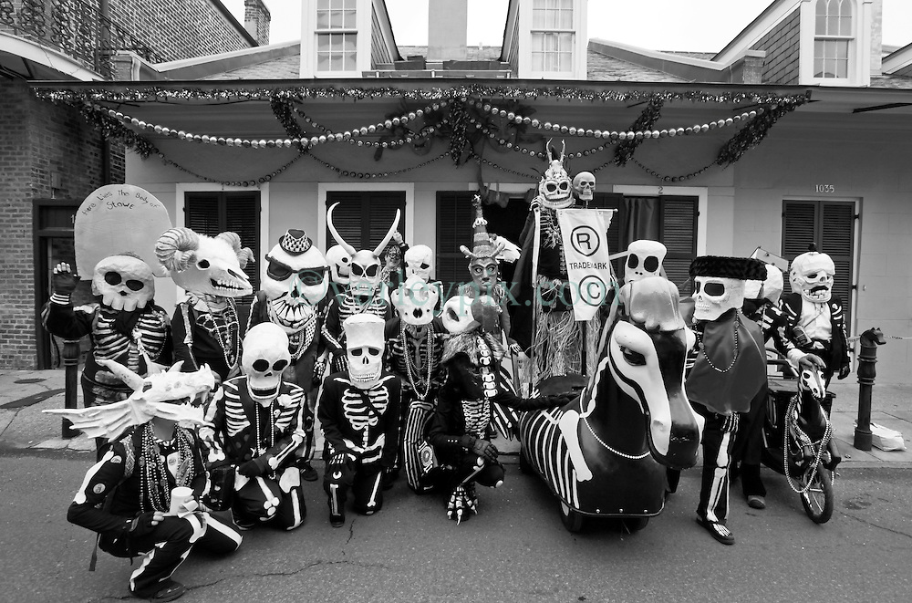 17 Feb 2015. New Orleans, Louisiana.<br /> Mardi Gras Day. Walking with Skeletons. <br /> The Skeleton Krewe poses for a portrait in the French Quarter. The Skeleton Krewe meets before dawn beside a cemetery in Uptown New Orleans. They then walk several miles Along Saint Charles Avenue to the French Quarter to celebrate Mardi Gras Day.<br /> Photo; Charlie Varley/varleypix.com