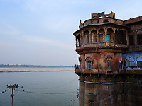 Varanasi, INDIA - CIRCA NOVEMBER 2018: Old building in the ghats of Ganges River in Varanasi. Varanasi is the spiritual capital of India, the holiest of the seven sacred cities and with that one the most frequented places for Sadhus.