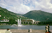 Lovers meet on waterside with fountain at Lille Lungegårdsvannet lake, Bergen, Norway,  1970