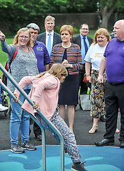 Pictured: Nicola Sturgeon watches children play on one of the climbing frames.<br /> <br /> First Minister Nicola Sturgeon opened Scotland's largest 'inclusive' play park at Pittencrief Park in Dunfermline.<br /> <br /> © Dave Johnston/ EEm