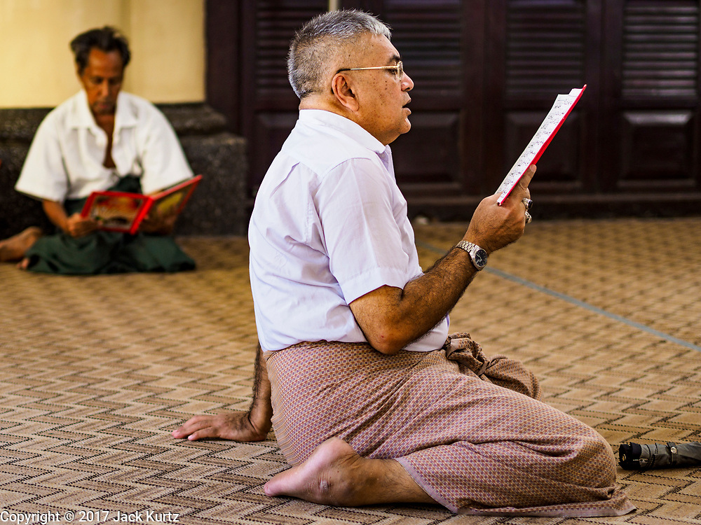 """24 NOVEMBER 2017 - YANGON, MYANMAR: A man prays in Mogul Shiah Mosque in Yangon. Many Muslims in overwhelmingly Buddhist Myanmar feel their religion is threatened by a series of laws that target non-Buddhists. Under the so called """"Race and Religion Protection Laws,"""" people aren't allowed to convert from Buddhism to another religion without permission from authorities, Buddhist women aren't allowed to marry non-Buddhist men without permission from the community and polygamy is outlawed. Pope Francis is to arrive in Myanmar next week and is expected to address the persecution of the Rohingya, a Muslim ethnic minority in western Myanmar. Some Muslims and Christians are concerned that if the Pope's comments take too strong of pro-Rohingya stance, he could exacerbate religious tensions in the country.  PHOTO BY JACK KURTZ"""
