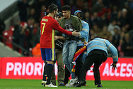 stewards remove a Pitch invader who attempts to get to Alvaro Morata of Spain after full time. England v Spain, Football international friendly at Wembley Stadium in London on Tuesday 15th November 2016.<br /> pic by John Patrick Fletcher, Andrew Orchard sports photography.