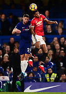 Marcos Rashford of Manchester United and Gary Cahill of Chelsea jump for the ball . Premier league match, Chelsea v Manchester United at Stamford Bridge in London on Sunday 5th November 2017.<br /> pic by Andrew Orchard sports photography.