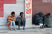Men from Udaipur are freezing one cold morning in February.