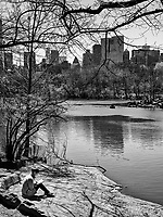 Relaxing by The Lake  in Central Park with the Midtown skyscrapers looming in the distance.