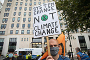 Extinction Rebellion 'Shell Out' protest on 8th September 2020 in London, United Kingdom. The environmental group gathered outside the Shell building to protest at the ongoing extraction of fossil fuels and the resulting environmental record. Extinction Rebellion is a climate change group started in 2018 and has gained a huge following of people committed to peaceful protests. These protests are highlighting that the government is not doing enough to avoid catastrophic climate change and to demand the government take radical action to save the planet.
