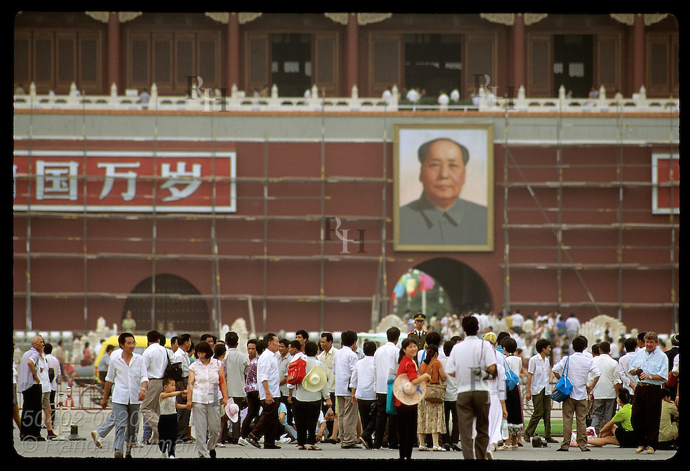 Mao's portrait on Workers' Cultural Palace towers above Tiananmen Square crowds in Beijing. China